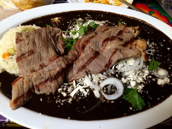 Guelaguetza: Enmoladas... tortillas covered in black mole and a choice of meat (I chose carne aside)