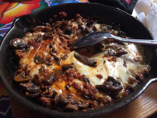 Guelaguetza: Quesillo Fundido... skillet dish that incorporates Oaxaca cheese, grilled chorizo and mushrooms.
