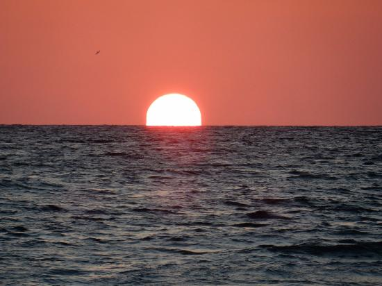 Sandpiper Inn: sun setting into the gulf from our favorite beach