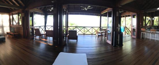 Secret Bay: Panoramic of the living room with all doors to balcony opened