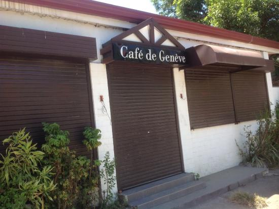 Cafe de Geneve: Closed; shuttered; electrical wiring dangling