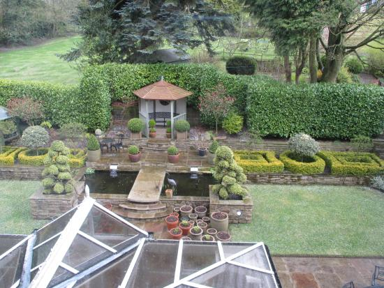 Cononley, UK: Part of the garden and fish pond.