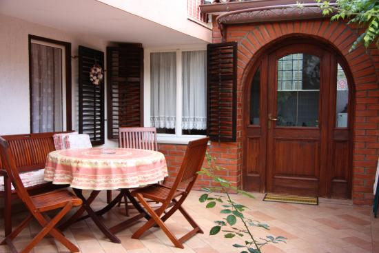 Villa Lucu: Patio and apartment entrance.