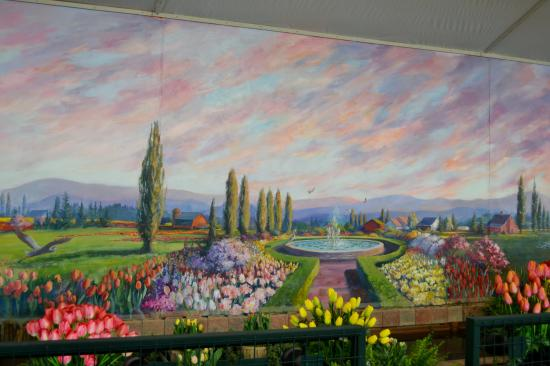 Beautiful hand painted wall murals at Tulip Town upon entry