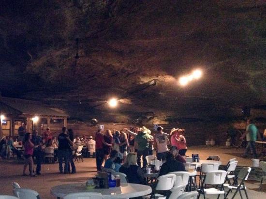 Tuscumbia, AL: Night shot of people dancing in Rattlesnake Saloon cave