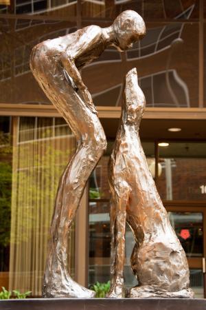 SculptureWalk Sioux Falls: Who Rescued Who, Lorri Acott sculptor