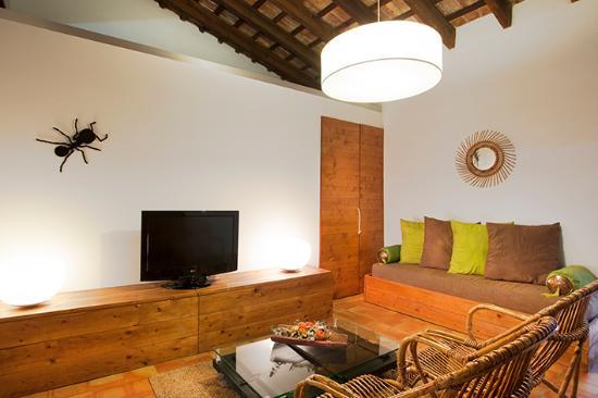 Casa Arizo: Zona estar planta rústica