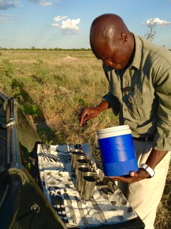 "Camp Savuti: Our guide preparing gin and tonics for our ""sundowners"""