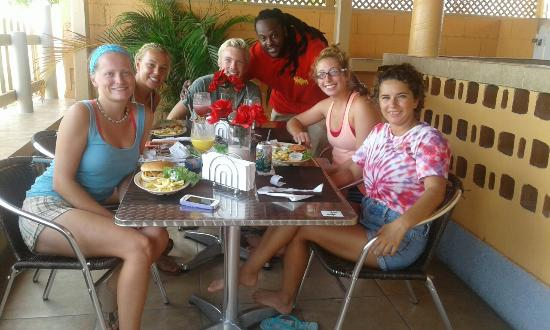 """South Caicos: SFS Students enjoying their delicious island food with Chef """"Darell""""."""