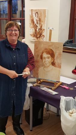 Kidsgrove, UK: Mo Frost painting her granddaughter Roisin at Mazart Studio