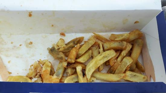 Budleigh Salterton, UK: Black chips - not very premier I'd say.  Shame, this used to be a good chippy.