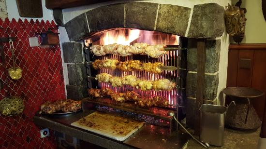Auberge de Dully: Chickens being grilled