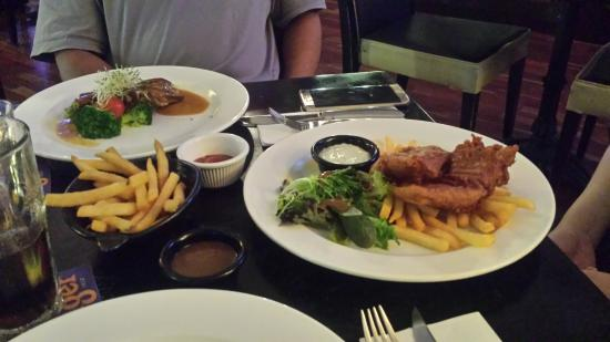The Bank Bar + Bistro: Fish & chips and pork meal