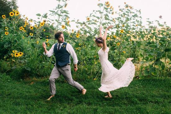 Friendly Crossways Retreat Center: Bride and Groom Celebrating in the Sunflowers