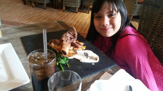 Tangerine Grill: She is 7 years old, the short ribs bigger than her head! haha