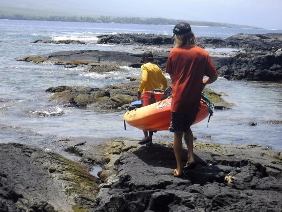 Kealakekua, HI: Illi and AJ launching our kayaks near the monument to head back.