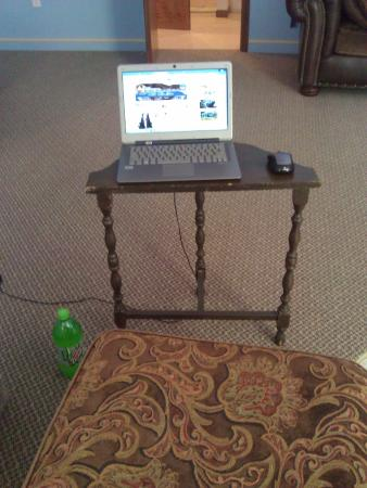 Jamesport, MO: Wobbly make shift table and foot stool