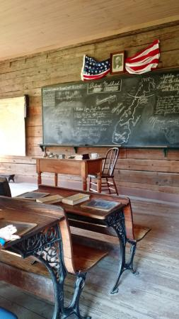 Eagle, WI: School was in session with lessons to be learned & teacher/docent assisting students to find ans
