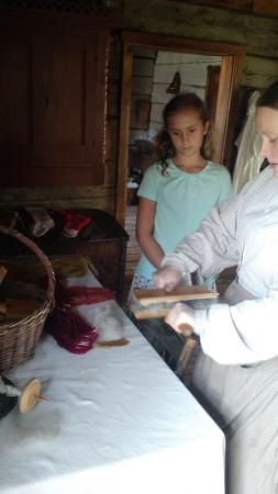 Eagle, WI: Docent demonstrates how wool is cleaned, washed & dries for spinning.
