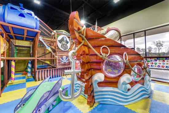 The Woodlands, TX: IGI Playground It's every kid's dream. Tunnels and trampolines, a zip line, and a candy bar all