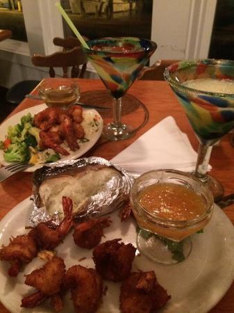 Charlotte Plummer's Seafare Resturant: Lukewarm frozen shrimp. Good Margaritas! Nasty sauces! Reheated rice.