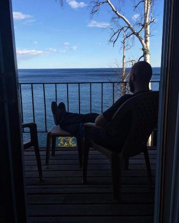 Lutsen, MN: Husband, enjoying the beautiful view from room 203.
