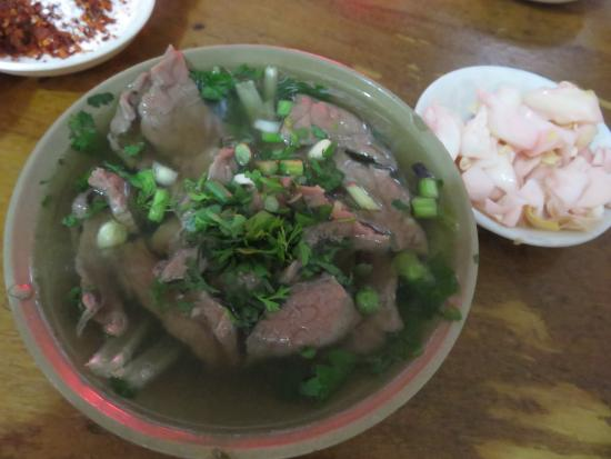 Boiled beef in broth with herbs and spices, Side pickled