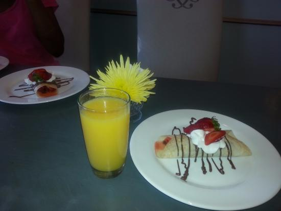 Anniston, AL: Fresh squeezed orange juice, Surprise individual strawberry crepes brought to our table! Delicio