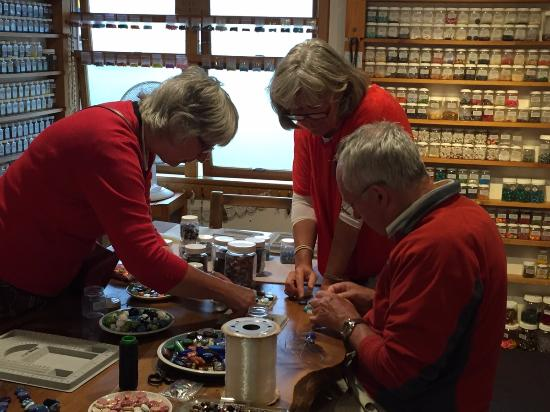 The Bead Shop: Engrossed in making a necklace with the help of Lee Eliott