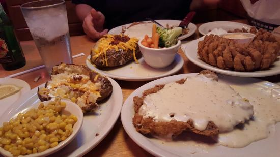 Texas Roadhouse: Onion blossom, Loaded baked potato, Chicken fried steak smothered in gravy. Need I say more!
