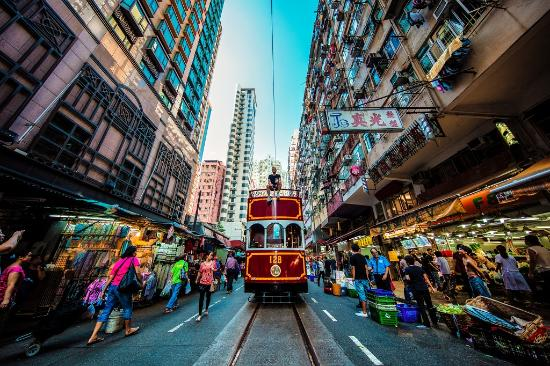 Hong Kong, China: A tram passing by the North Point wet market.