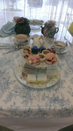Magnolia Terrace Tea Room: Our table setting. Sandwiches and confections