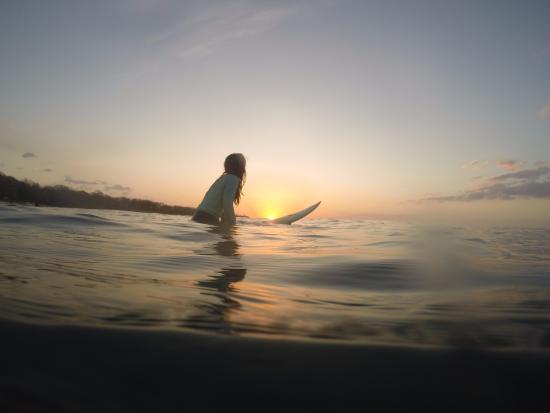 Sunset surf near Tamarindo Backpackers