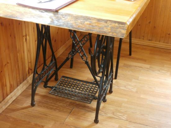 Crandon, WI: Tables with treadle sewing machine base.