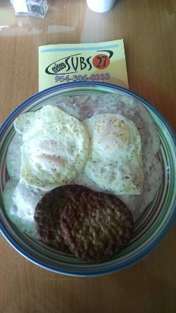 Wilton Manors, FL: Breakfast. Biscuits & Gravy sausage and two eggs.