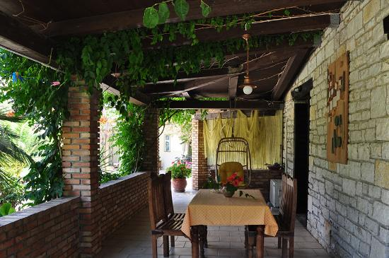 Seaside Apartments: Shaded porch on the ground floor of the Stone Villa