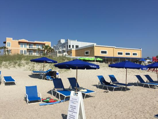 Hotel Chairs And Umbrellas On The Beach