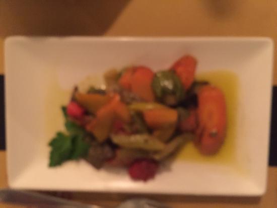 Ratatouille Suckling pick, scallops on pea purée