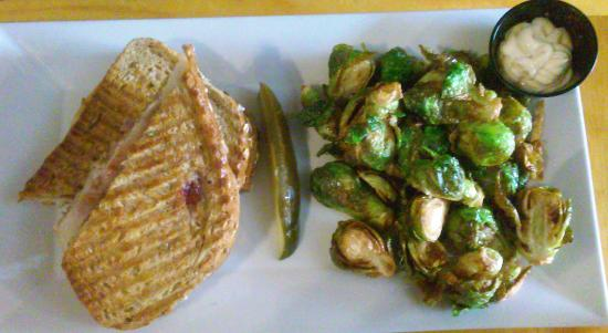 Native Kitchen & Social Pub: panini with turkey, brie, ham and sour cherry and a side of fried brussell sprouts