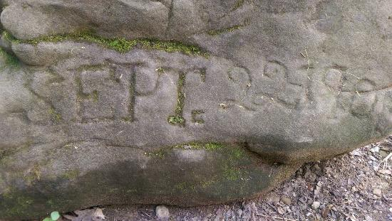 Howard, OH: A boulder with an inscription in it from turn off the century.
