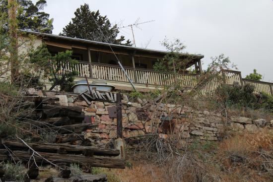 Jerome, AZ: House with front yard bathtub.
