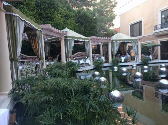 View of koi pond and outdoor seating from table along for Koi pond wynn