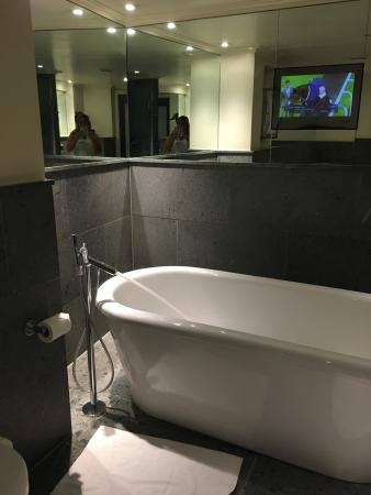 The May Fair Hotel: Awesome bathroom in our room 101......and outside the front door has something for the car enthu