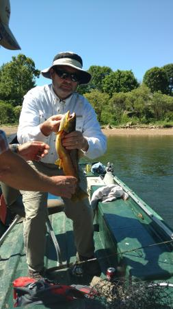 """Cotter, AR: Catching our big Brown... but just under 24"""" limit and had to toss her back for another day.."""