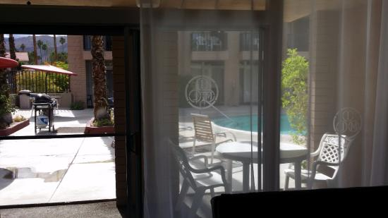 International Hotel & Suites: sliding door leading to the pool