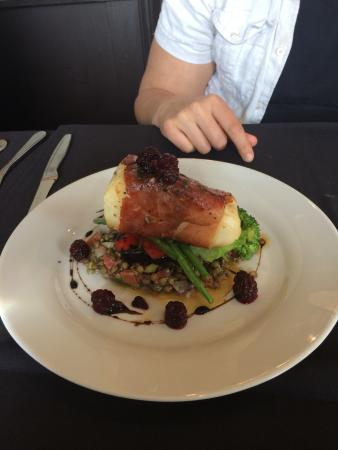 Barrie, Canada: Prosciutto wrapped Chilean sea bass with puy lentil salsa and macerated blackberries