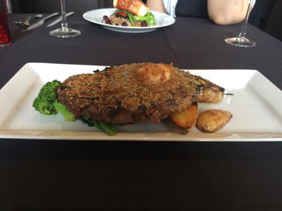 Barrie, Canada: 12 oz rib eye crusted with rosemary and pistachio, topped with fig bacon butter