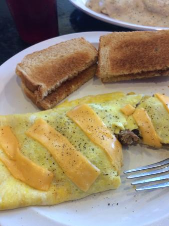 Arnold, MO: Sausage and cheese omelet with wheat toast and a side of biscuits/gravy.