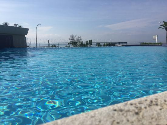 The pool is eye level with the ocean picture of four - Hotels in catania with swimming pool ...
