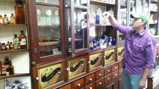 Cuero, TX: Our tour guide the medicines. Below are hand painted windows with an interesting story.
